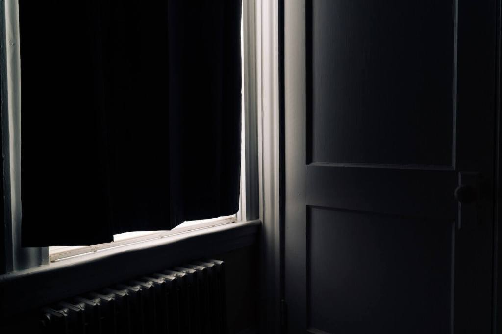 Photo of light coming through shades of a closed window during Covid-19 Quarantine