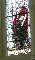 Stained-glass window depicting founder Rahere as a jester