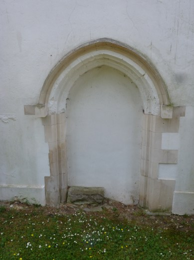 Detail of blocked-up Medieval doorway