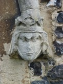 4 - Carved stone head of Edward III's Queen Philippa beside porch