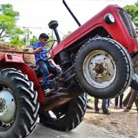 Watch this 10-Year-Old Kid Perform Insane Stunts with a Tractor