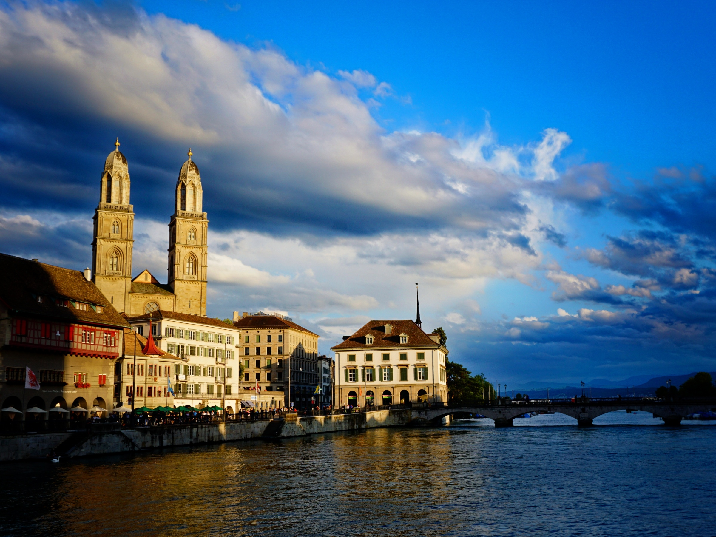 The Grossmünster in Zurich by the Limmat river before sunset.
