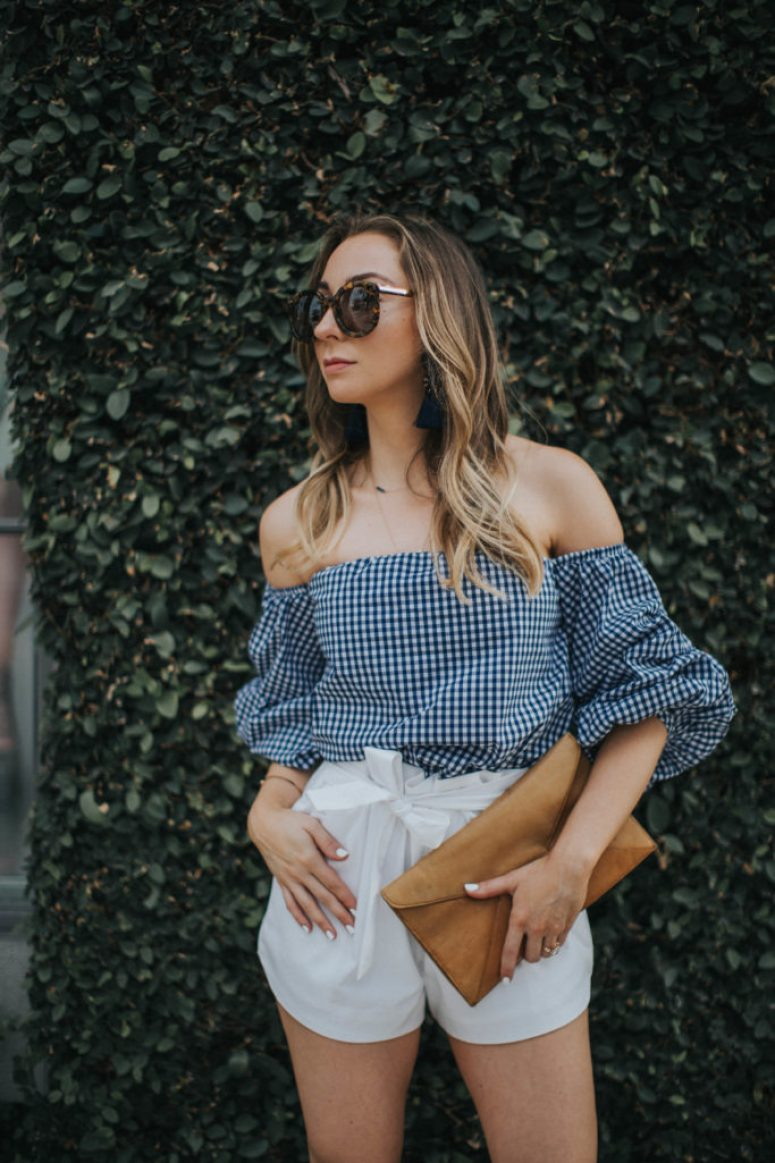 Blue gingham off the hsoulder top, white bow shorts, tassel earrings