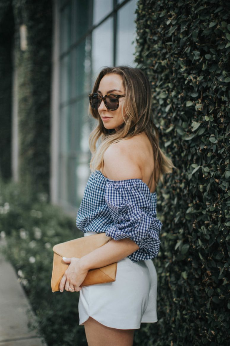 Spring Outfit : Blue gingham off the shoulder top, white shorts, tan clutch