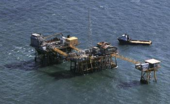 Rescue crew surrounds an oil platform operated by Houston-based Black Elk Energy which exploded off the coast of Louisiana in the Gulf of Mexico, in this November 16, 2012 file photo. REUTERS/Sean Gardner/Files