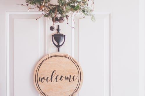 Welcome Home sign on front door