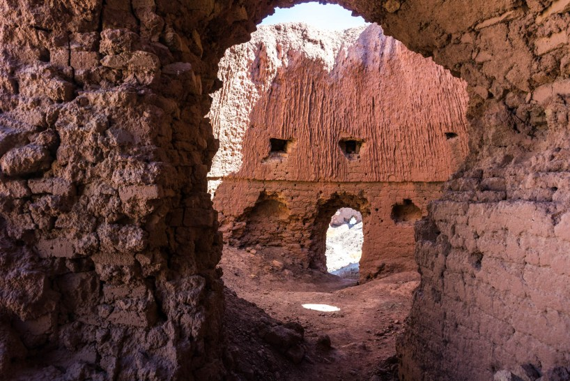 The red stone interior of the Shahr-e-Zohak citadel near Bamiyan, Afghanistan - Lost With Purpose