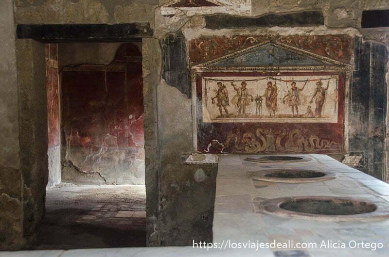 taberna con pintura en la pared visita a pompeya