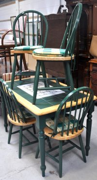A modern tile topped kitchen table with four spindle back ...