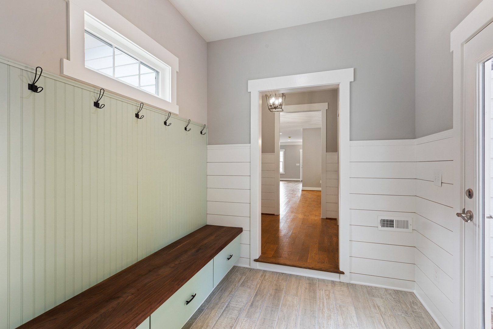 Mudroom with shiplap and built-in storage