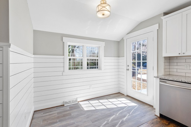 Dining room with shiplap walls