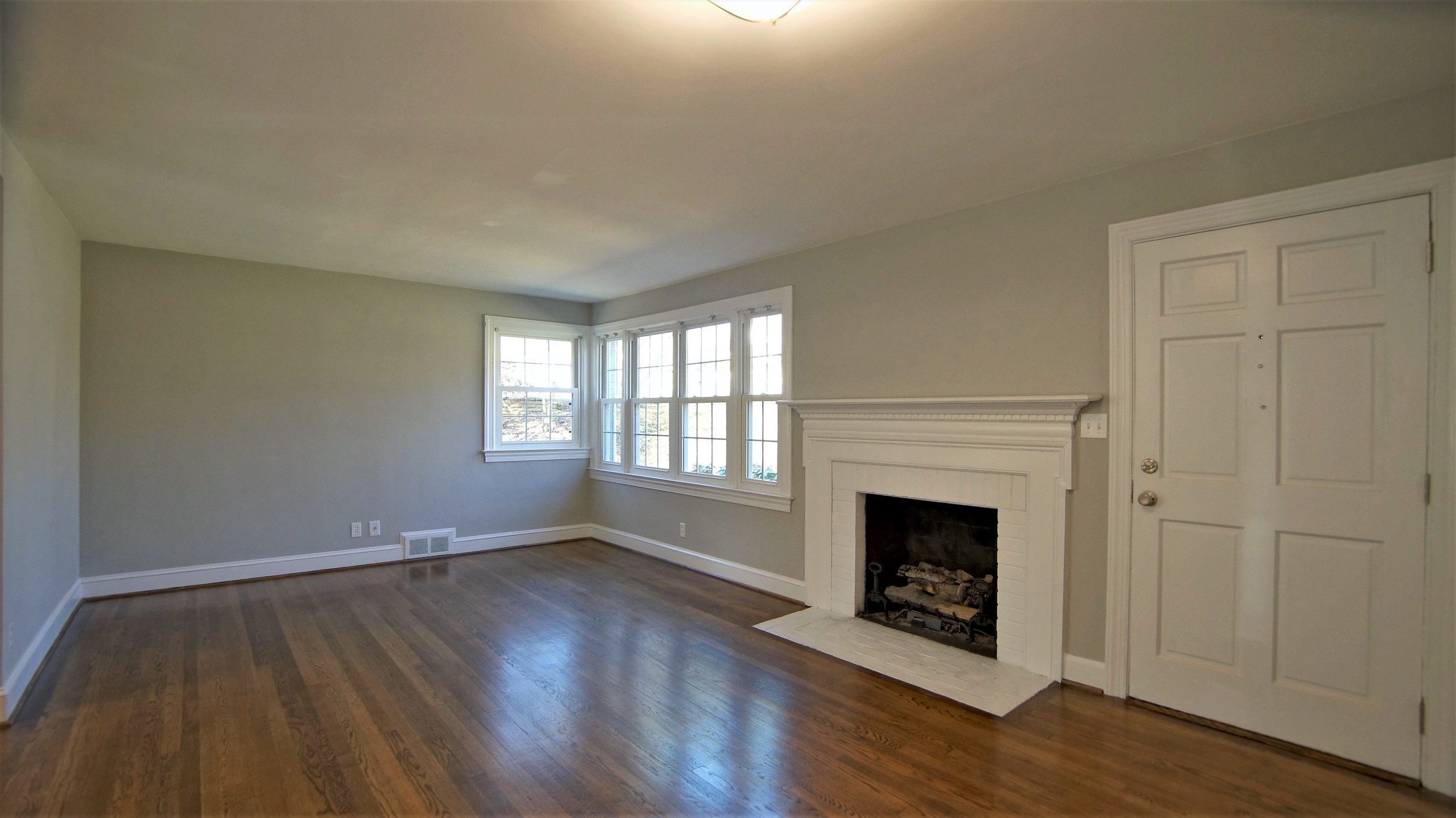 Painted fireplace and refinished floors in Ardmore home
