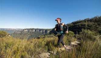 Woman trailrunning in the Australia bush