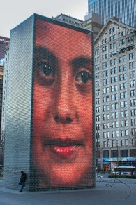 A giant collection of screens depicting one massive face in Millenium Park in Chicago | LotsaSmiles Photography