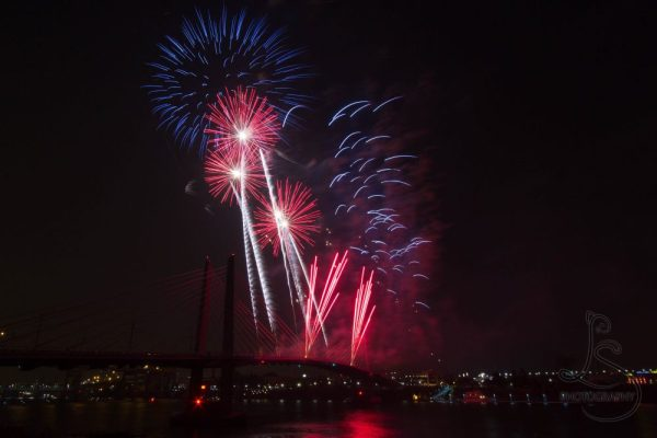 Red fireworks over Portland's Tilikum Crossing   LotsaSmiles Photography