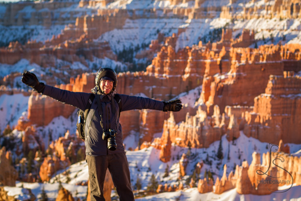 Aaron welcoming the beautiful Bryce landscape behind him | LotsaSmiles Photography