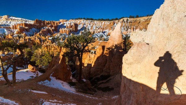 My shadow on the rock as I shoot Bryce Canyon in the distance | LotsaSmiles Photography