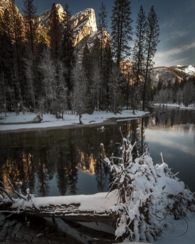 The Three Brothers awake from their frozen slumber in Yosemite National Park.