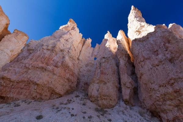 A rock wall, standing proudly mostly in shadow in Bryce Canyon | LotsaSmiles Photography