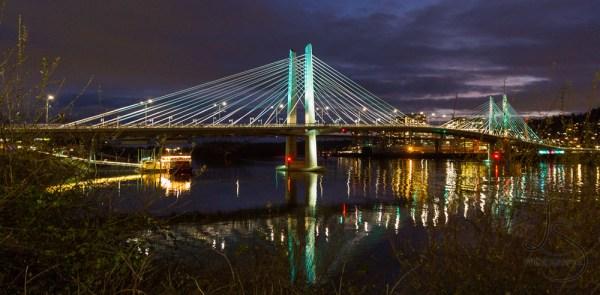 The illuminated Tilikum Crossing in Portland at night | LotsaSmiles Photography