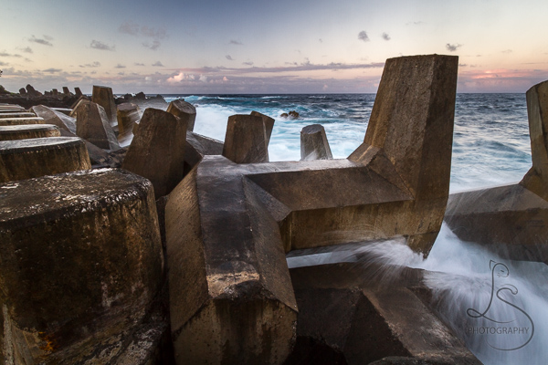 Waves crashing over concrete tetrapods | LotsaSmiles Photography