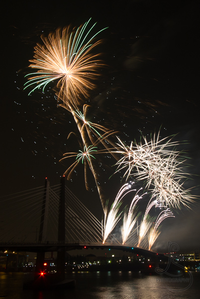 Yellow and green fireworks over Portland's Tilikum Crossing | LotsaSmiles Photography