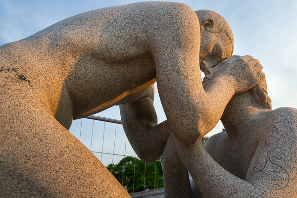 Two statues with foreheads touching in Vigeland Park | LotsaSmiles Photography