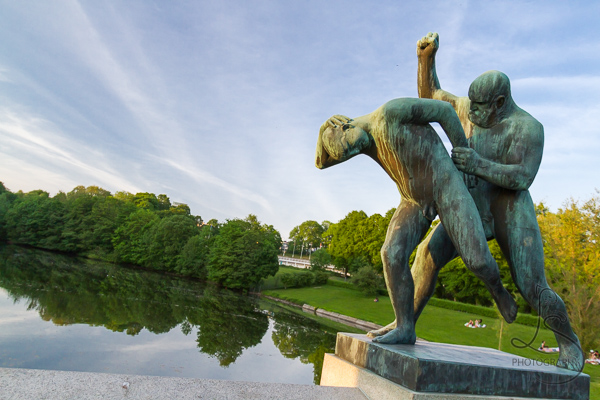 Two male statues on the bridge in Vigeland Park | LotsaSmiles Photography