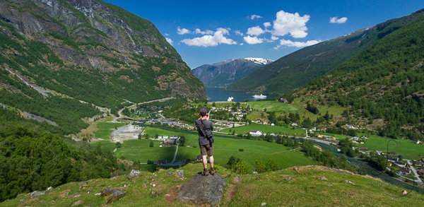 Aaron standing at the Brekkefossen viewpoint, looking out at the Flam valley | LotsaSmiles Photography