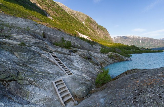 Wooden steps dug into the rocks along the Nigardsbreen glacier trail in Norway | LotsaSmiles Photography