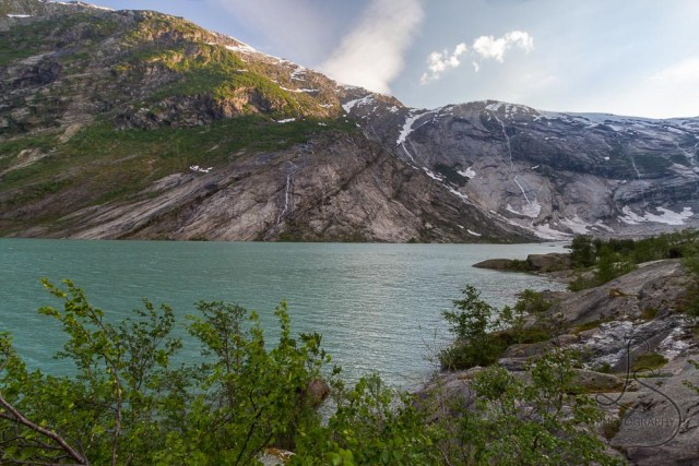 The clear line on the canyon wall where vegetation ceases and ice begins toward the Nigardsbreen glacier in Norway | LotsaSmiles Photography