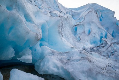 The magnificently blue Nigardsbreen glacier astounds visitors in Norway