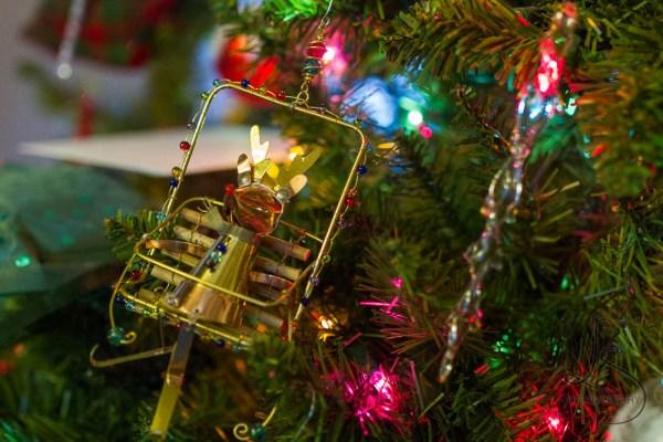 Reindeer ornament on a Christmas tree   LotsaSmiles Photography