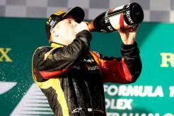 Kimi Raikkonen, Lotus F1, 1st position, celebrates on the podium with Champagne.