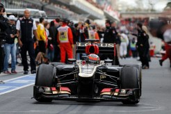 Kimi Raikkonen, Lotus E21 Renault, heads to Parc Ferme after victory.