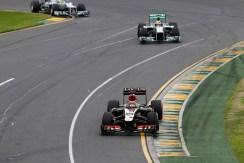 Kimi Raikkonen, Lotus E21 Renault, leads Lewis Hamilton, Mercedes W04, and Nico Rosberg, Mercedes W04.