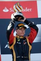 Kimi Raikkonen, Lotus F1, 2nd position, lifts his trophy on the podium