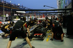 Kimi Raikkonen, Lotus E21 Renault arrives in the pits for a practice stop.