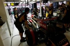 Lotus mechanics prepare to launch Pastor Maldonado, Lotus E22 Renault, in to the session.