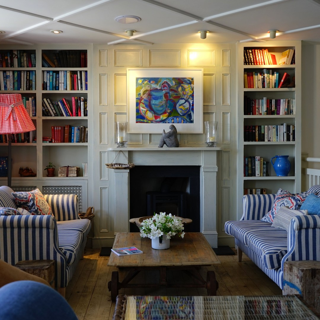 bookshelves and stripped couches in living room