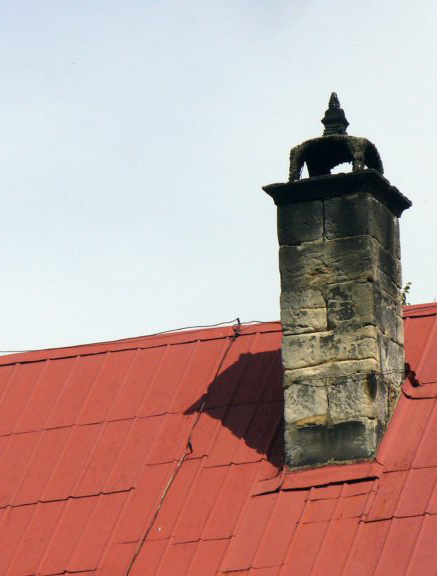 smoke stained chimney on red roof