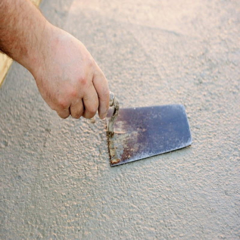 man working on stucco and cement
