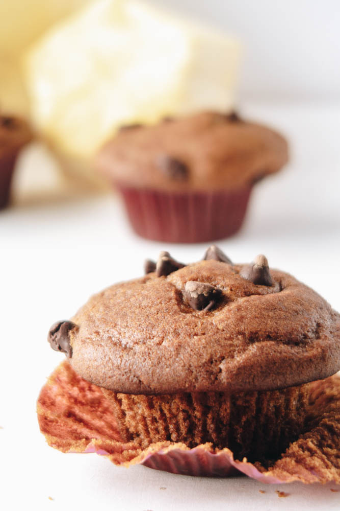 Side view of a unweraped Vegan Pumpkin Muffins with Chocolate Chips with