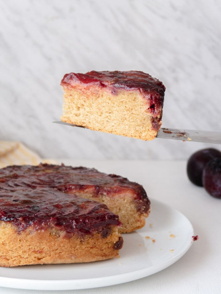 plum vegan weed cake slice in the air