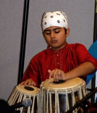 Young Sikh musician on drums