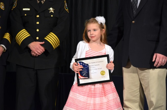 Aubrey Perry accepts the Meritorious Civilian Award for her quick action to get medical attention for her father when he was experiencing a diabetic emergency. (Danielle Nadler/Loudoun Now)