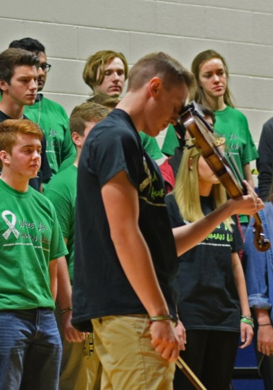 Jordan Bartel performs a song dedicated to his brother, Ryan, who took his own life in 2014. (Photo by Alexis Ward)