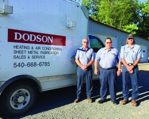 Al Dodson, center, with his sons, Kelly Dodson and Michael Dodson.