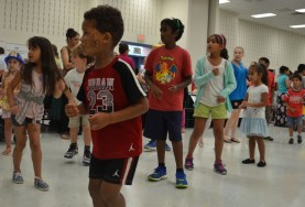 """Kids dance to """"Uptown Funk"""" at the Community Services Night organized by Community Advocates for Education on Monday. (Danielle Nadler/Loudoun Now)"""