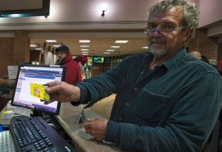 David Carter, of Oakton, MD, lined up just before midnight to purchase the first Jingle Jam tickets of the season. [Douglas Graham/Loudoun Now]